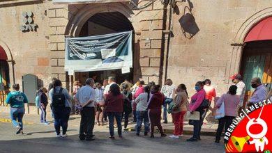 Photo of #Denúnciamesta Sin sana distancia y a media calle, morelianos hacen filas en el SAT